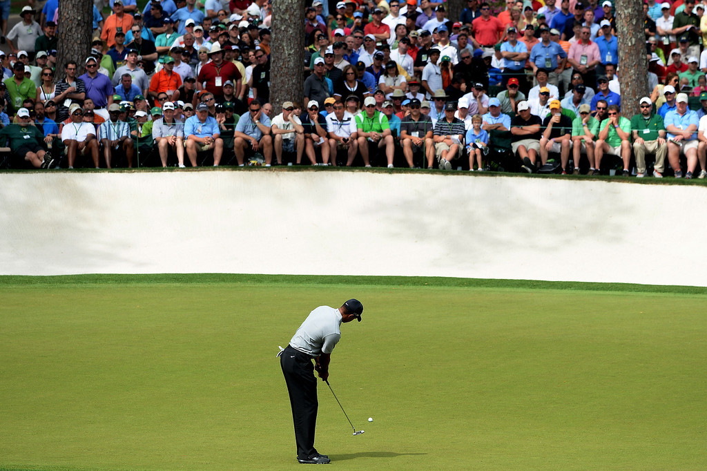 . Tiger Woods of the United States putts on the 16th hole during the first round of the 2013 Masters Tournament at Augusta National Golf Club on April 11, 2013 in Augusta, Georgia.  (Photo by Harry How/Getty Images)
