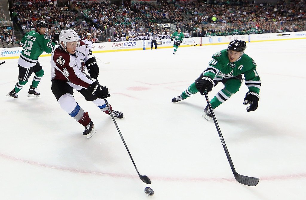 . Erik Johnson #6 of the Colorado Avalanche skates the puck against Shawn Horcoff #10 of the Dallas Stars at American Airlines Center on December 17, 2013 in Dallas, Texas.  (Photo by Ronald Martinez/Getty Images)