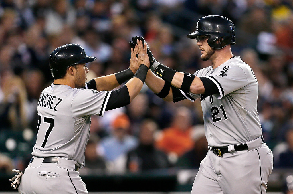 . Chicago White Sox\'s Tyler Flowers, right, is congratulated by Carlos Sanchez after hitting a two-run home run against the Detroit Tigers in the second inning of a baseball game in Detroit Monday, Sept. 22, 2014. (AP Photo/Paul Sancya)