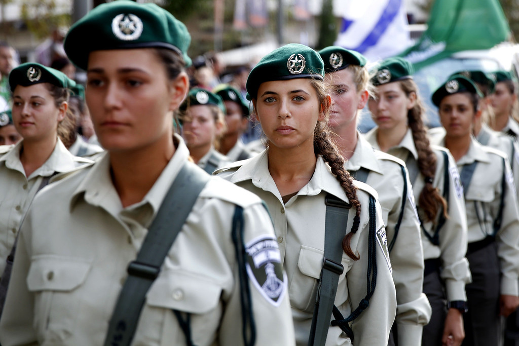 . Israeli border policewomen march during a parade in celebration of the Jewish holiday of Sukkot (Tabernacles) and to express solidarity with Israel, in downtown Jerusalem, on September 24, 2013. Thousands of Israelis and Christian Evangelical supporters of the Jewish state marched today during their annual parade marking the Jewish holiday of Sukkot or the Feast of the Tabernacles. GALI TIBBON/AFP/Getty Images