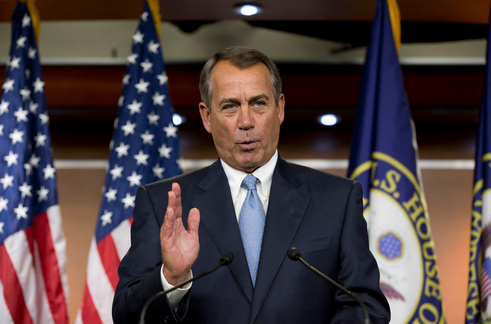Description of . House Speaker John Boehner of Ohio takes questions from reporters on gun control, immigration and the budget during a news conference on Capitol Hill in Washington, Thursday, April 11, 2013.  (AP Photo/J. Scott Applewhite))