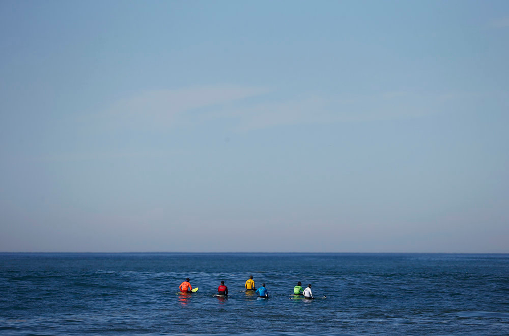 Description of . A group of contestants wait for a wave during the Mavericks Invitational surf competition in Half Moon Bay, California January 20, 2013. REUTERS/Stephen Lam