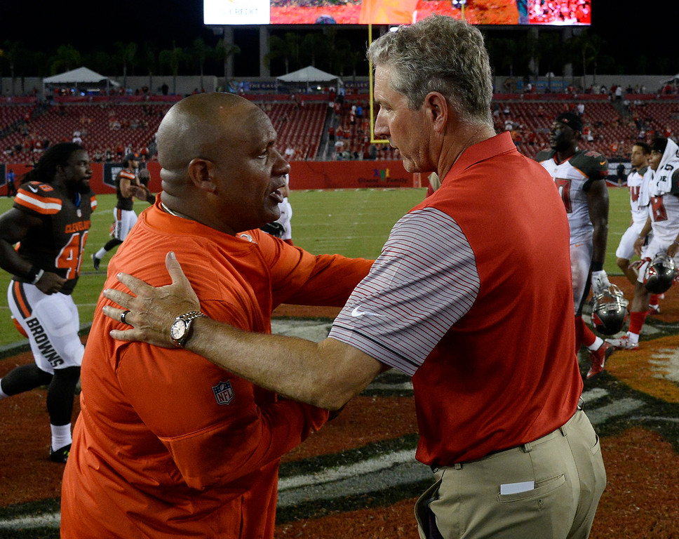 . Tampa Bay Buccaneers head coach Dirk Koetter, right, congratulates Cleveland Browns head coach Hue Jackson after the Bucs defeated the Browns 30-13 during an NFL preseason football game Friday, Aug. 26, 2016, in Tampa, Fla. (AP Photo/Jason Behnken)