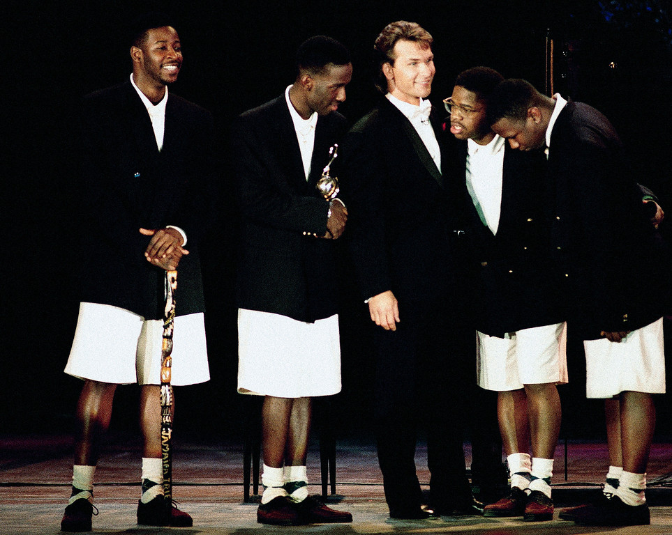 . Members of the rock group, Boyz II Men, of Philadelphia, receive their trophy from movie star Patrick Swayze, center, during the World Music Awards in Monte Carlo on May 12, 1993. Boyz II Men�s award was for the best new group of the year. (AP Photo/Gilbert Tourte)