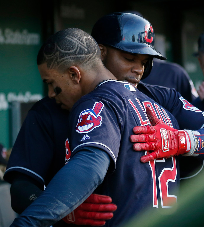 . Cleveland Indians\' Rajai Davis, rear, is congratulated by teammate Francisco Lindor after scoring a run during the third inning of a baseball game against the Chicago Cubs on Wednesday, May 23, 2018, in Chicago. (AP Photo/Jim Young)
