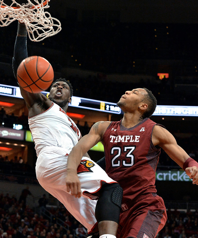 . Louisville\'s Montrezl Harrell, left, dunks against Temple\'s Devontae Watson during the second half of an NCAA college basketball game, Thursday, Feb. 27, 2014, in Louisville, Ky. Louisville defeated Temple 88-66. (AP Photo/Timothy D. Easley)