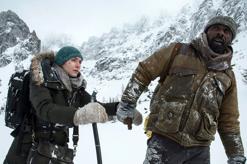 ". Kate Winslet, left, and Idris Elba in a scene from ""The Mountain Between Us,\"" in theaters Oct. 6. (Kimberley French/Twentieth Century Fox via AP)"