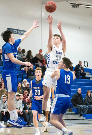 02/11/20 Wesley Bunnell | StaffrrPlainville boys basketball at home on Tuesday night against Lewis Mills. AJ Lestini (11).