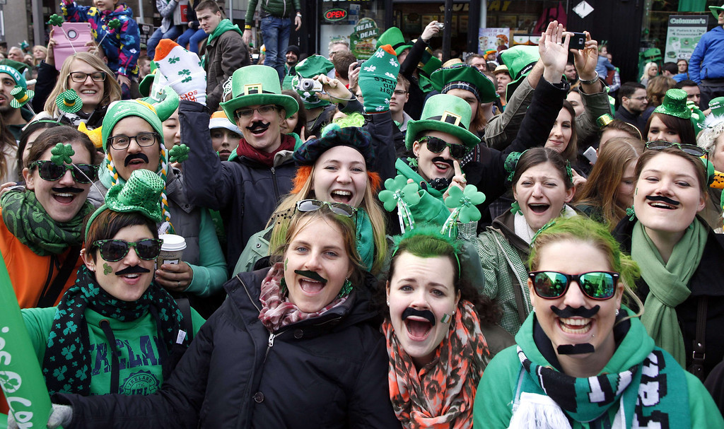 . Spectators attend St Patrick\'s Day parade in Dublin on March 17, 2014. More than 100 parades are being held across Ireland to mark St Patrick\'s Day, the feast day of the patron saint of Ireland, with up to 650,000 spectators expected to attend the parade in Dublin. AFP PHOTO/ PETER MUHLY/AFP/Getty Images