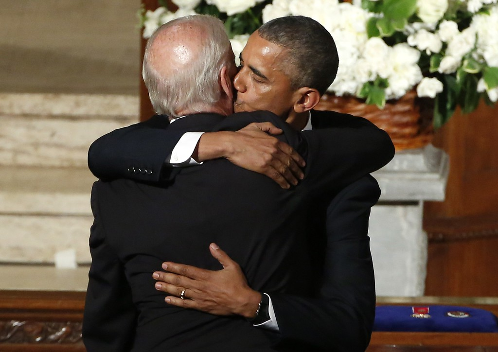 . US President Barack Obama (R) hugs Vice President Joe Biden during funeral services for Beau Biden at St. Anthony of Padua Church in Wilmington, Delaware, on June 6, 2015. Obama delivered the eulogy for Vice President Joe Biden\'s son, Beau, who lost his battle with brain cancer at age 46. AFP PHOTO/YURI GRIPAS/AFP/Getty Images