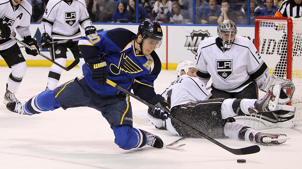 . Blues left wing Alexander Steen, left, tries to maintain control of the puck as Los Angeles defenseman Rob Scuderi, second from right and goaltender Jonathan Quick defend in first period action during Game 5 of the Western Conference quarterfinals between the St. Louis Blues and the Los Angeles Kings on Wednesday, May 8, 2013, at the Scottrade Center in St. Louis. (AP Photo/St. Louis Post-Dispatch, Chris Lee)