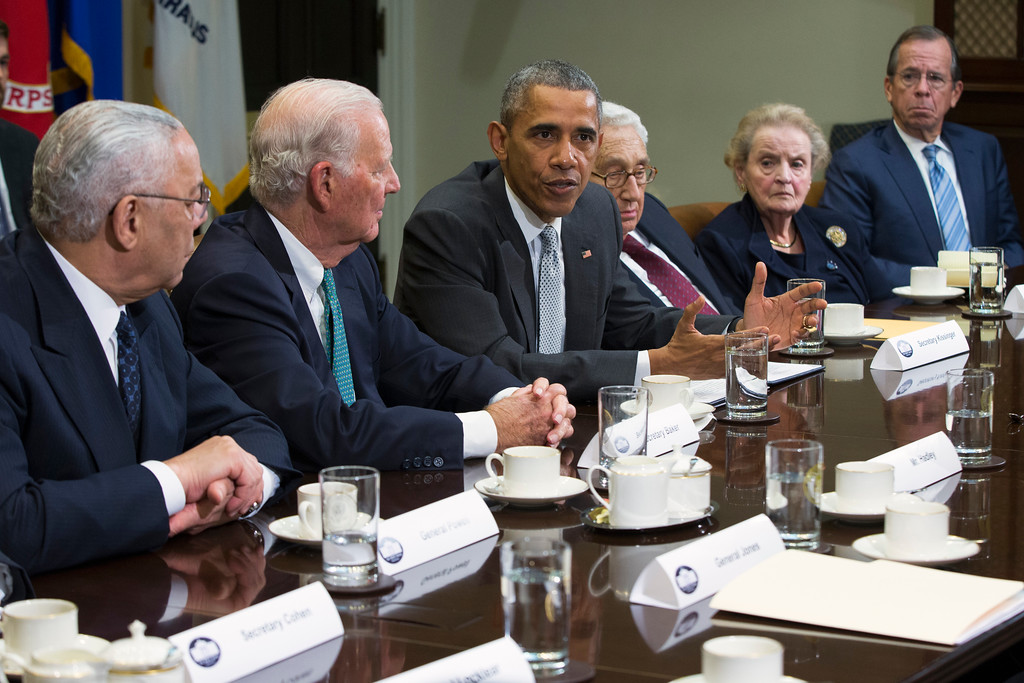 . President Barack Obama speaks during a meeting with national security leaders to discuss the Trans-Pacific Partnership trade agreement, Friday, Nov. 13, 2015, in the Roosevelt Room of the White House in Washington. Joining him, from left are, former Secretaries of State Colin Powell, James A. Baker III, Henry Kissinger, Madeleine Albright, and former Joint Chiefs Chairman Mike Mullen. (AP Photo/Evan Vucci)