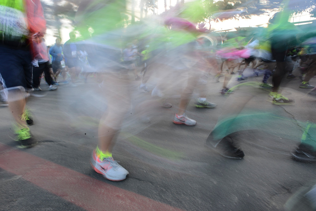 . A blur of runners and shoes at the start of the LA Marathon Sunday at Dodger Stadium. Photo by David Crane/Staff Photographer