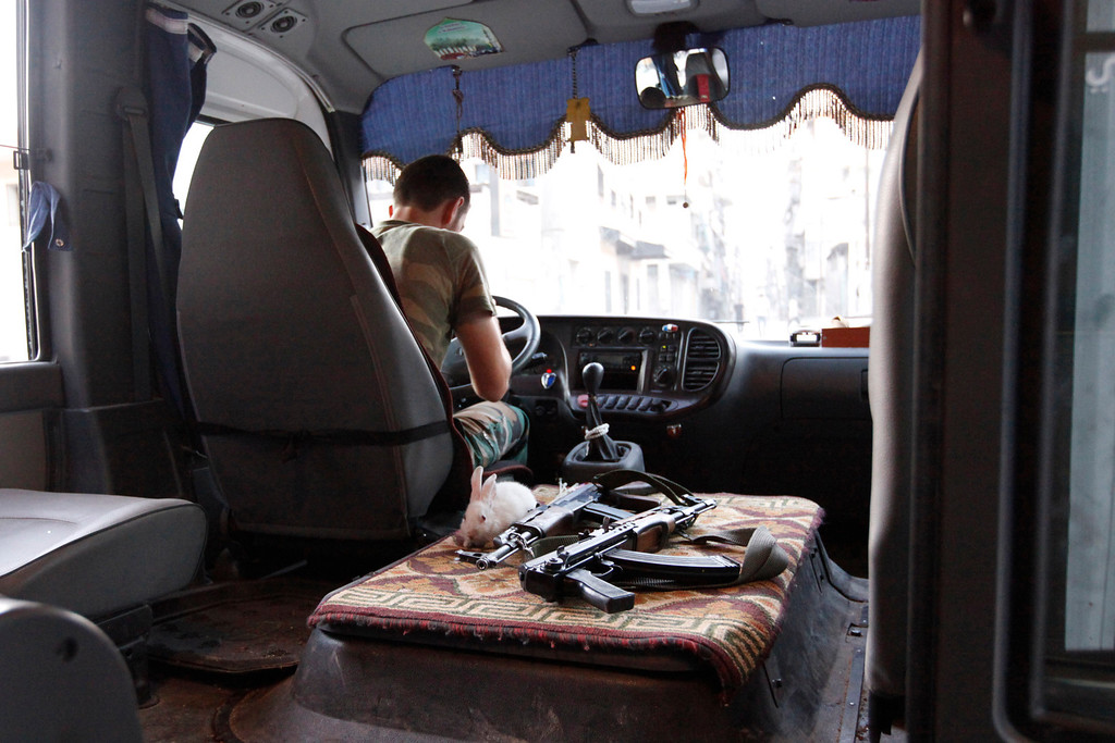 . A rabbit is pictured next to weapons in a Free Syrian Army bus in Bustan Al-Basha district in Aleppo September 18, 2012. REUTERS/Zain Karam