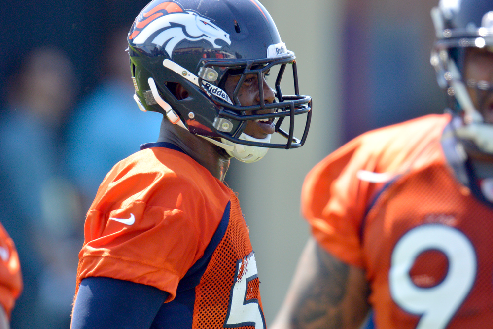 . Denver Broncos :B Von Miller (58) looks on during drills at training camp July 26, 2013 at Dove Valley. (Photo By John Leyba/The Denver Post)