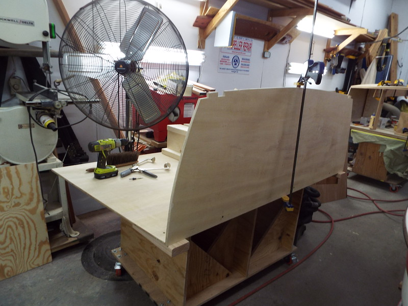 Transom being fit to the love seat bottom.