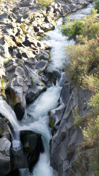 River on lava bed Francovilla Sicily