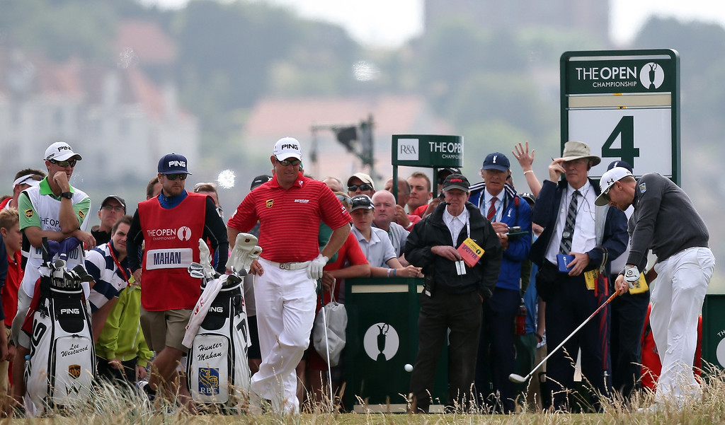 . US golfer  Hunter Mahan (R) tees off on the fourth during the fourth and final round of the 2013 British Open Golf Championship at Muirfield golf course at Gullane in Scotland on July 21, 2013.     ADRIAN DENNIS/AFP/Getty Images