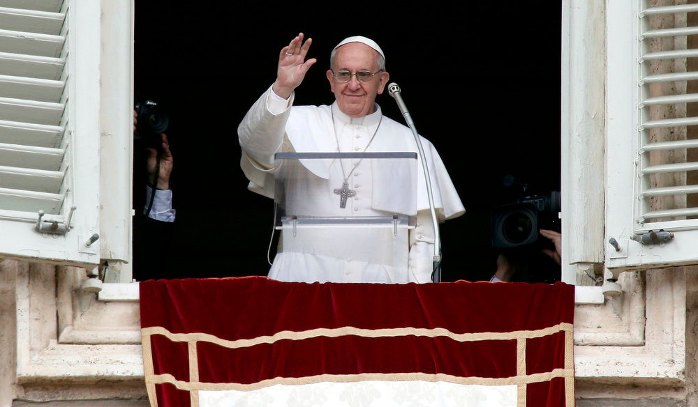 . Newly elected Pope Francis appears at the window of his future private apartment to bless the faithful, gathered below in St. Peter\'s Square, during the Sunday Angelus prayer at the Vatican March 17, 2013. REUTERS/Tony Gentile