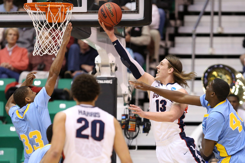 . SALT LAKE CITY, UT - MARCH 21:  Kelly Olynyk #13 of the Gonzaga Bulldogs shoots in front of Javan Mitchell #44 of the Southern University Jaguars in the first half during the second round of the 2013 NCAA Men\'s Basketball Tournament at EnergySolutions Arena on March 21, 2013 in Salt Lake City, Utah.  (Photo by Streeter Lecka/Getty Images)