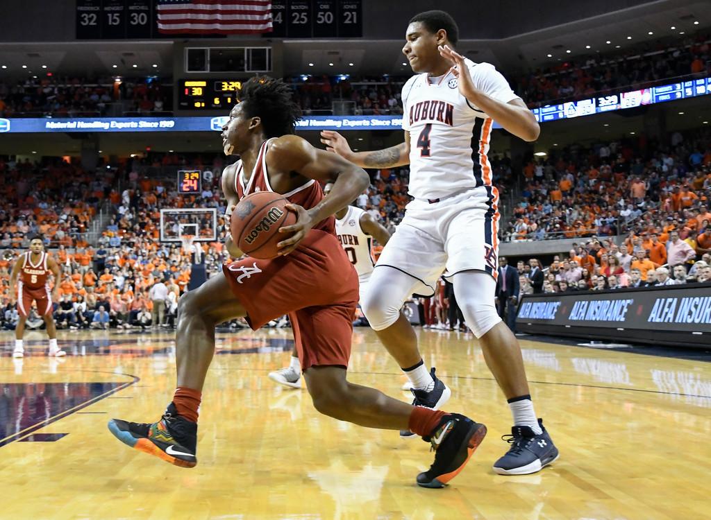 . Alabama guard Collin Sexton drives to the basket past the defense of Auburn forward Chuma Okeke (4) during an NCAA college basketball game Wednesday, Feb. 21, 2018, in Auburn, Ala. Auburn won 90-71. (AP Photo/John Amis)