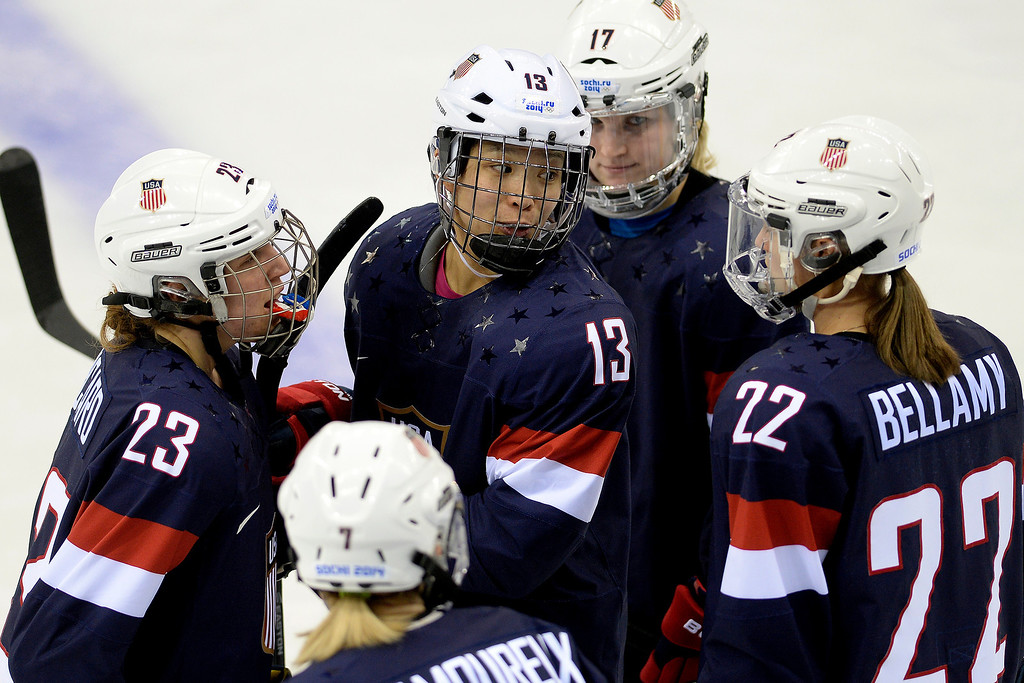 . Julie Chu (13) of the U.S.A. speaks with teammates Kacey Bellamy (22), Monique Lamoureaux (7), Michelle Picard (23), and Jocelyne Lamoureaux (17) during the third period of the United States\' 9-0 win at the Shayba Arena. Sochi 2014 Winter Olympics on Monday, February 10, 2014. (Photo by AAron Ontiveroz/The Denver Post)