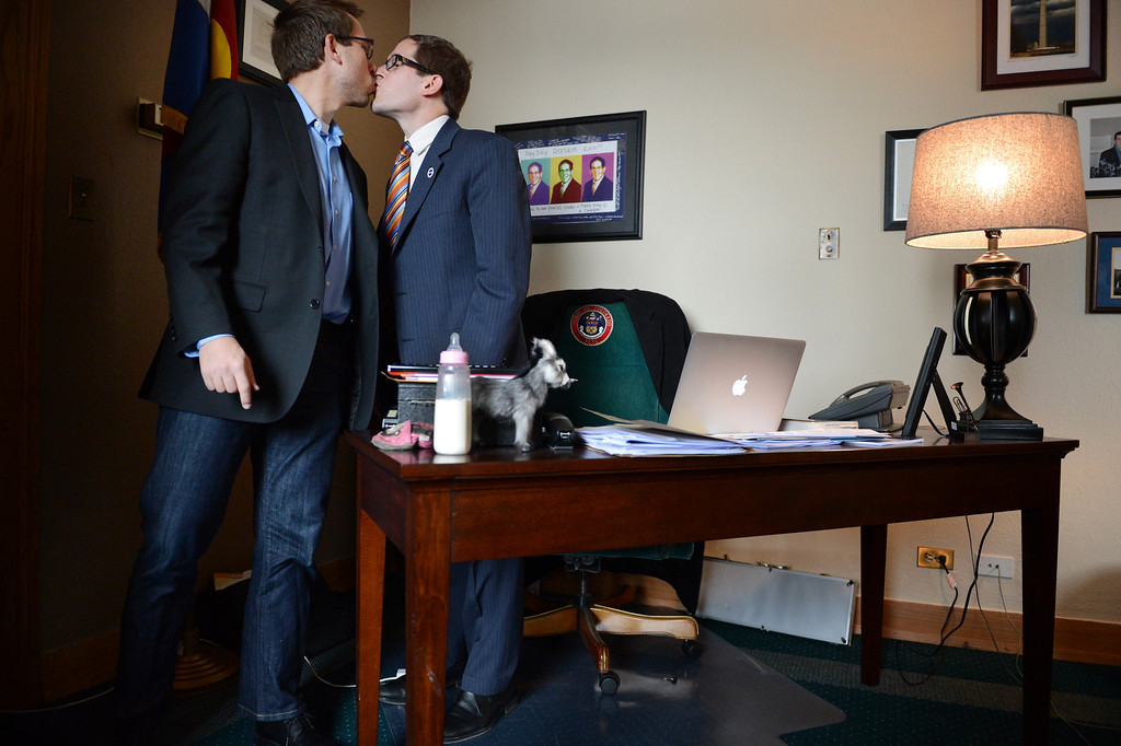 . House Speaker Mark Ferrandino, D-Denver,, right, says goodbye to his partner, Greg Wertsch following the vote on Senate Bill 11 at the Colorado House of Representatives in Denver, CO March 12, 2013. Senate Bill 11 is sponsored by Ferrndino of Denver and Rep. Sue Schafer of Wheat Ridge, two gay Denver Democrats. The Bill passed and will allow gay couples to form civil unions in Colorado. (Photo By Craig F. Walker/The Denver Post)