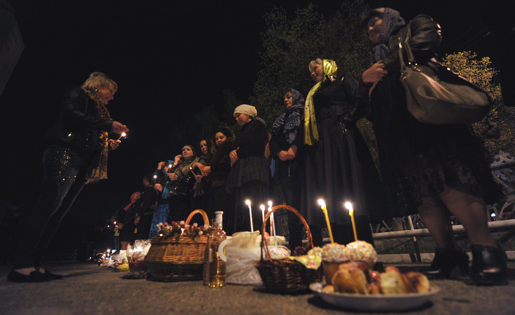 . Orthodox believers light candles as they celebrate an Orthodox Easter during a midnight mass at a church in Bishkek on early April 20, 2014. AFP PHOTO/ VYACHESLAV  OSELEDKO/AFP/Getty Images