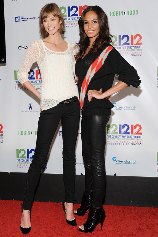 """. From left, models Karlie Kloss and Chanel Iman appear backstage at \""""12-12-12\"""" The Concert for Sandy Relief, on Wednesday, Dec. 12, 2012 in New York. (Photo by Evan Agostini/Invision/AP Images)"""