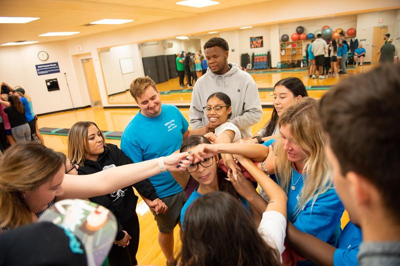 Professor Wilson-Garza's Small Group Communications class do teambuilding exercises in the Dugan Wellness Center.