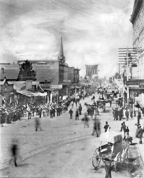 View of a celebration on Spring Street, taken looking south from First Street, ca.1888