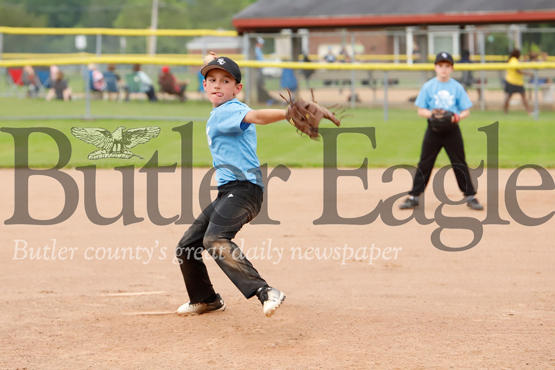 Kolton Walsh winds up to pitch in Seneca Valley North Athletic Association 9-10 year old playoff action Monday night. Walsh's Blue Team topped the Gold team 9-3 to advance. Seb Foltz/Butler Eagle