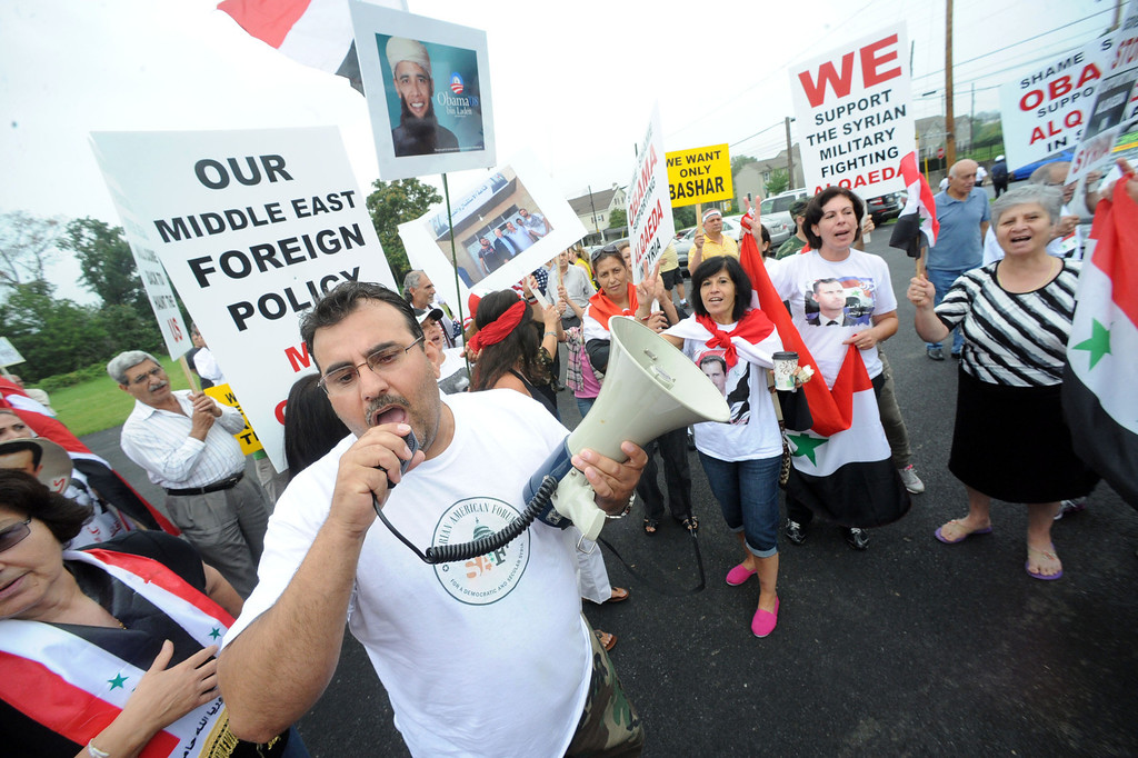 . Gus Soud of Allentown, Pa.,  uses the loud speaker during the Syrian community protest against U.S. or NATO involvement in Syria\'s unrest Friday, Aug. 30, 2013, in Allentown, Pa. (AP Photo/ Express-Times, Sue Beyer)
