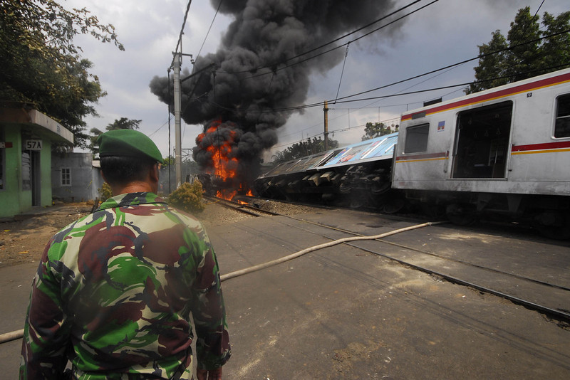 . Military personel observe  the train wreck on December 9, 2013 on the outskirts Jakarta, Indonesia. A commuter train collided with a vehicle reportedly carrying liquefied gas canisters at around 11:20am local time. At least five people are reported dead.  (Photo by Nurcholis Anhari Lubis/Getty Images)