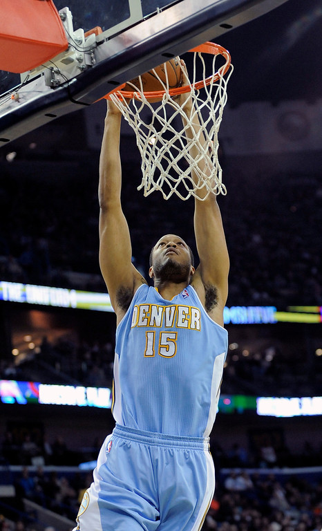 . Denver Nuggets forward Anthony Randolph (15) scores against the New Orleans Pelicans during the first half of an NBA basketball game in New Orleans, Friday, Dec. 27, 2013. (AP Photo/Stacy Revere)