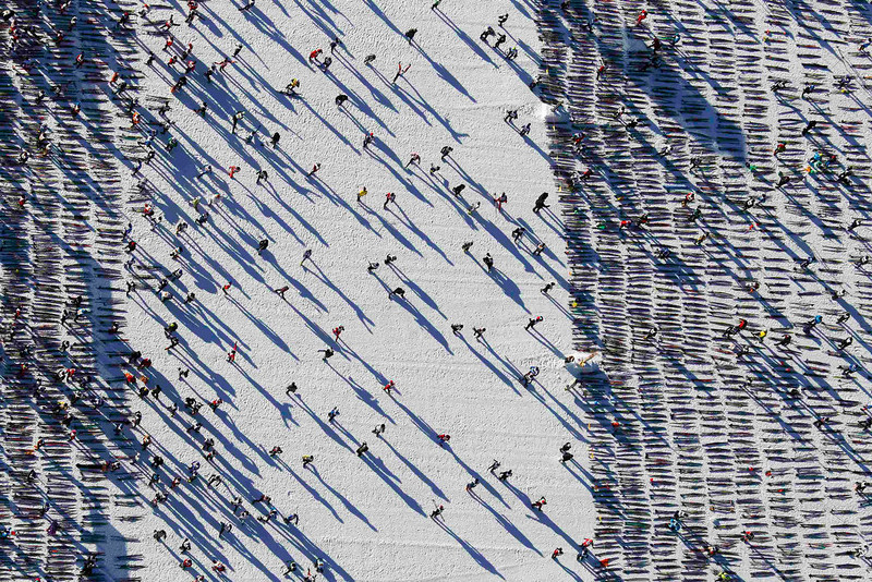 . An aerial view shows cross-country skiers await the start of the Engadin Ski Marathon on the frozen Lake Sils near the village of Maloja March 10, 2013. More than 12,000 skiers participated in the 26.2 miles race between Maloja and S-chanf near the Swiss mountain resort of St. Moritz. REUTERS/Michael Buholzer