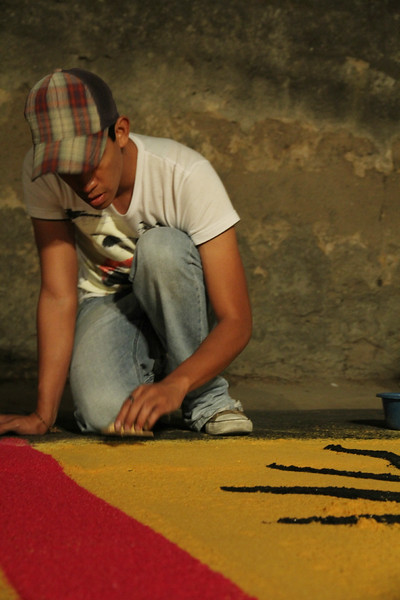 A man creates a decorative alfombra (carpet) for Holy Weeks processions to walk over in Antigua, Guatemala on March 16, 2013. Photo by Scott Umstattd