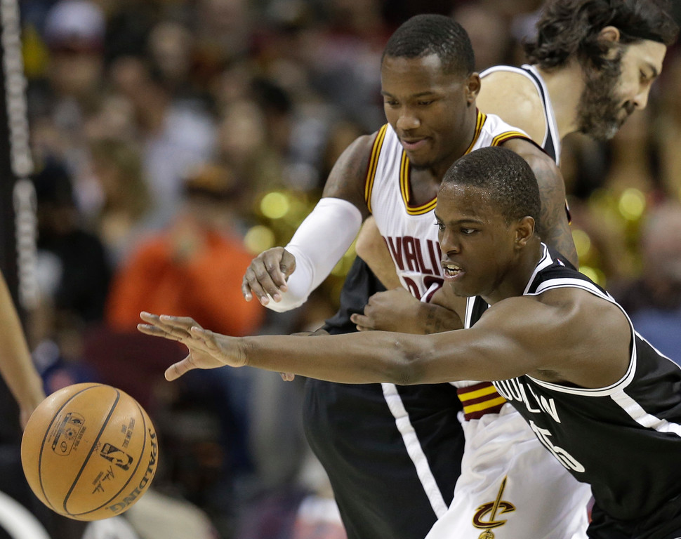 . Brooklyn Nets\' Isaiah Whitehead, front, and Cleveland Cavaliers\' Kay Felder reach for a loose ball during the second half of an NBA basketball game, Friday, Jan. 27, 2017, in Cleveland. The Cavaliers won 124-116.(AP Photo/Tony Dejak)