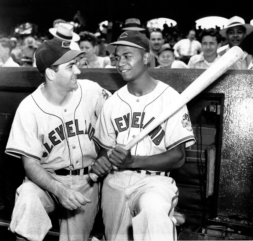 . Manager Lou Boudreau and Larry Doby, first black player in the American League, stand in the dugout at Comiskey Park in Chicago, Ill., on July 5, 1947.  (AP Photo)