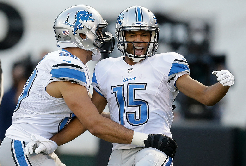 . Detroit Lions wide receiver Golden Tate (15) celebrates after scoring on a 28-yard touchdown reception, with tight end Joseph Fauria during the first quarter of an NFL preseason football game against the Oakland Raiders in Oakland, Calif., Friday, Aug. 15, 2014. (AP Photo/Ben Margot)
