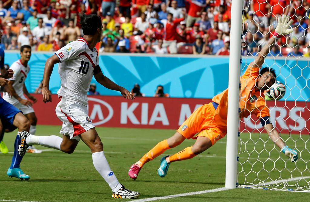 . Costa Rica\'s Bryan Ruiz (10) watches as the ball goes past Italy\'s goalkeeper Gianluigi Buffon to score his side\'s first goal during the group D World Cup soccer match between Italy and Costa Rica at the Arena Pernambuco in Recife, Brazil, Friday, June 20, 2014.  (AP Photo/Ricardo Mazalan)