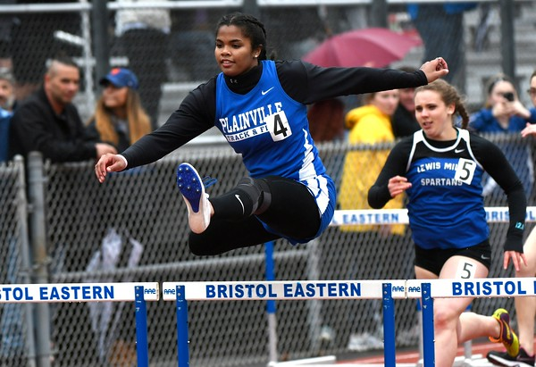 4/27/2018 Mike Orazzi | Staff Plainville High School's Sydni Spencer during the Bristol Eastern High School track invitational held on Friday.