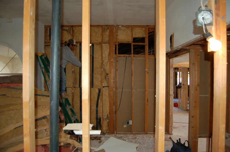 From the powder room into the study. You can see the kitchen through the door on the far right.