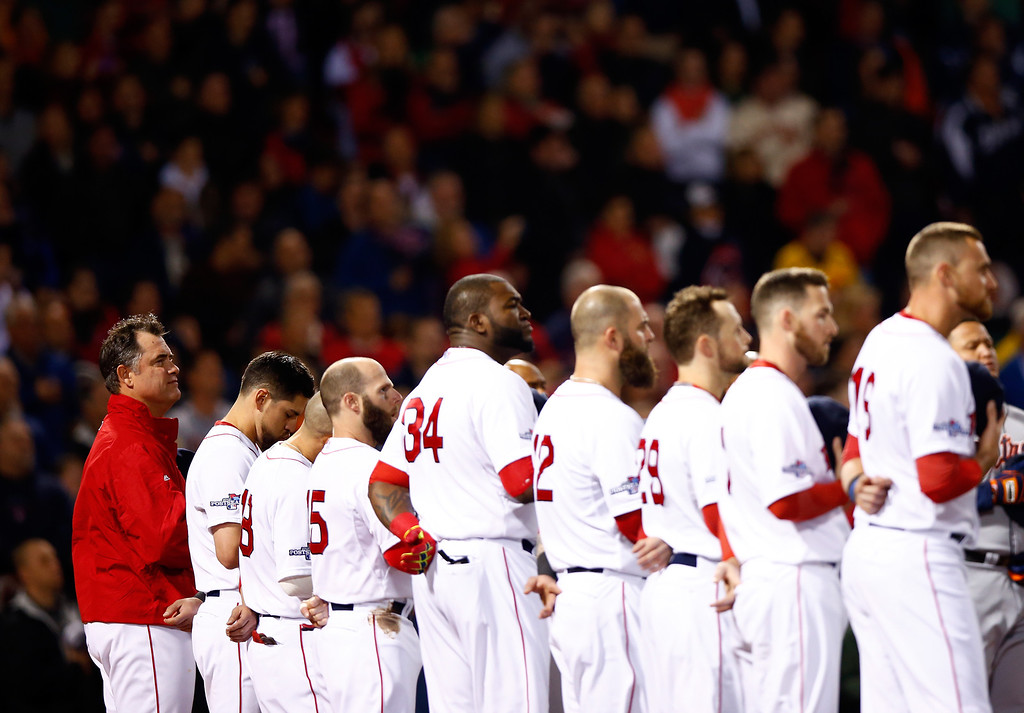. BOSTON, MA - OCTOBER 12: The Boston Red Sox line up before Game One of the American League Championship Series against the Detroit Tigers at Fenway Park on October 12, 2013 in Boston, Massachusetts.  (Photo by Jared Wickerham/Getty Images)
