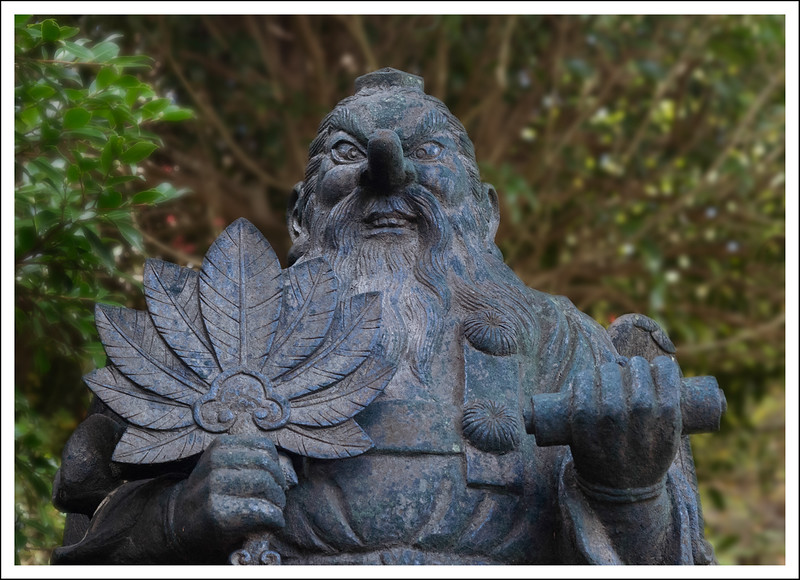 This temple has many tengu.  This statue was made of brass so has turned black.
