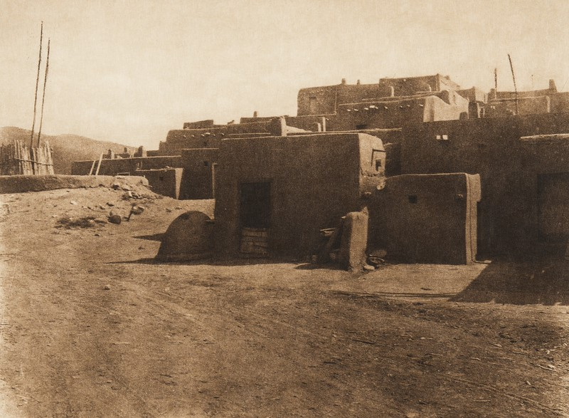 A corner of Taos and a kiva entrance (The North American Indian, v. XVI. Norwood, MA, The Plimpton Press,  1926)