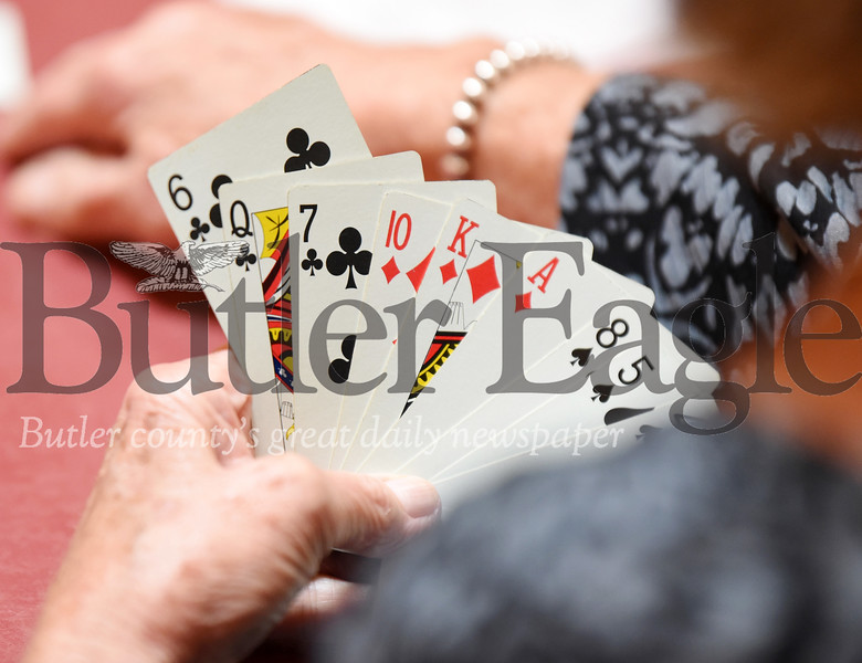 Harold Aughton/Butler Eagle: Pat Leclere of Pittsburgh keeps her hand close to the vest during a recent card club meeting at Mama Rosa's. The club has been meeting for the past 62 years.