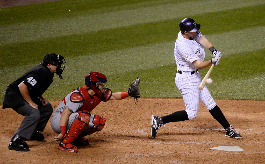 . DENVER, CO - JUNE 24: Colorado Rockies DJ LeMahieu (9) doubles down the right field line against the St. Louis Cardinals in the seventh inning June 24, 2014 at Coors Field. (Photo by John Leyba/The Denver Post)