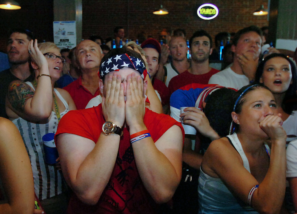 . U.S. fans react during the United States 2-1 loss to Belgium during the World Cup soccer match on Tuesday, July 1, 2014 at Ale Mary\'s at The Bittenbender in downtown Scranton, Pa.  (AP Photo/The Scranton Times-Tribune, Butch Comegys)