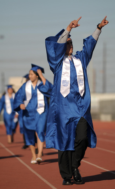 . Michael Gerardo points to family and friends. The 2013 North High School commencement ceremonies take place on the school\'s football field in Torrance Wednesday afternoon.